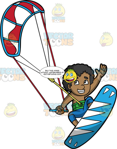 A Young Black Boy Excited To Be Out On His Kiteboard. A happy black boy wearing blue shorts, strapped onto a blue and white kiteboard, hangs onto a bar attached to a red and white power kite