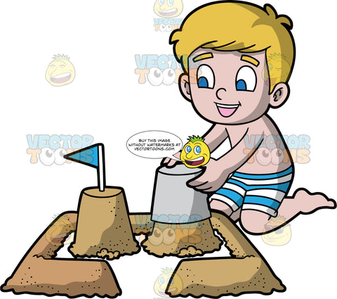 A Happy Boy Building A Sandcastle. A boy with blonde hair and blue eyes, wearing blue and white striped swim trunks, kneeling in the sand and emptying a bucket of sand in order to create the base of a sandcastle