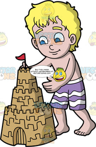 A Blonde Boy Admiring The Sandcastle He Built. A blonde boy with blue eyes, wearing purple and white swim trunks, stands next to the sandcastle he built and carefully pats down the side with his hand