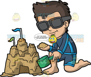 A Cool Boy Building A Sandcastle. A boy with brown hair, wearing blue swim trunks, a blue long sleeve sun shirt, and sunglasses, kneels beside a sandcastle and adds some sand to the top of it