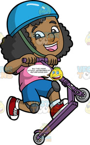 A Happy Black Girl On A Scooter. A black girl with curly hair, wearing a blue helmet with a green chin strap, pink shirt, blue shorts, dark gray knee pads, white socks, red with white sneakers, smiles while lifting her purple scooter with gray wheels as she jumps up