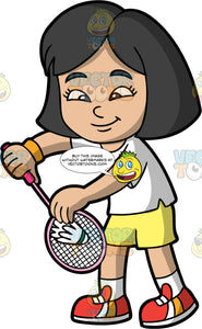 An Asian Girl Getting Ready To Serve A Shuttlecock. An Asian girl with black hair, wearing yellow shorts, a white t-shirt, white socks, and red, orange and white sneakers, holding a shuttlecock against her badminton racquet as she prepares to serve
