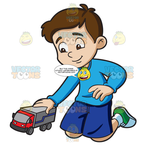 A Young Boy Playing With His Toy Truck