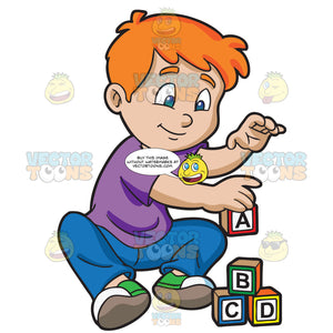A Young Boy Building Alphabet Blocks