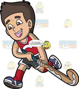 A Boy Running With A Field Hockey Stick. A boy with brown hair and eyes, wearing black and white shorts, a red tank top, red socks, and purple and white shoes, runs while holding a field hockey stick