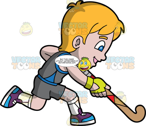 A Boy Running With A Field Hockey Stick In His Hands. A boy with blonde hair and blue eyes, wearing gray shorts, a gray and blue shirt, white socks, and purple and blue shoes, holds his hockey stick down and keeps his eye on the ground as he runs after a ball