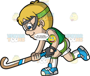 A Boy Chasing After A Field Hockey Ball. A boy with blonde hair and blue eyes, wearing white and green shorts, a green shirt, blue shoes and clear safety goggles, holds his field hockey stick low to the ground and chases after a ball