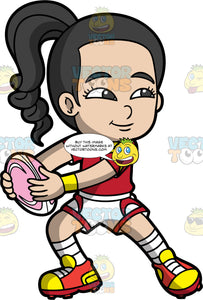 An Asian girl holding a pink and white rugby ball. An Asian girl with black hair tied up in a ponytail, wearing white and red shorts, a red and yellow shirt, white socks and red and yellow rugby cleats, stands and holds a pink and white rugby ball in both hands