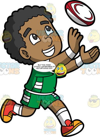 A black boy about to catch a rugby ball. A black boy wearing green and white shorts, a green and white shirt, white socks, and orange and yellow shoes, smiles as he holds his hands open to catch a rugby ball