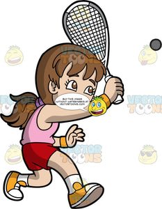 A Girl Having Fun Playing Squash. A girl with long brown hair tied back in a low ponytail, wearing red shorts, a pink shirt, white socks, and yellow shoes, holds a squash racquet in one hand an lunges forward to try and hit a squash ball coming towards her