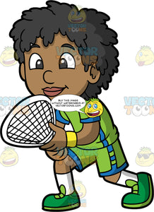 A Black Boy Ready For A Game Of Squash. A black boy wearing green and blue shorts, a green and blue shirt, white socks and green shoes, stands with a squash racquet in his hands, ready to play a match