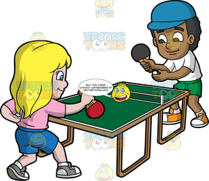 A Black Boy And White Girl Playing Table Tennis. A black boy kid wearing a teal cap, white shirt, green shorts, white socks, orange with white shoes, smiles while trying to serve the white ping pong ball using a black paddle, to his girl opponent with blonde hair at the other side of the green ping pong table, wearing a pink shirt, blue shorts, gray with white shoes and holding a red paddle