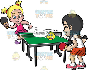 Two Competitive Girls Playing Table Tennis. A young girl with blonde hair in pig tails, wearing a pink dress, white socks, purple shoes, white wrist bands, smiles while hitting the bouncing white ping pong ball using a black paddle, to return to her other girl opponent on the other side of the green ping pong table, with black braided hair, white shirt, red skirt, white socks, pink shoes, who is holding a red paddle