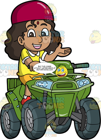 An Indian Girl Driving A Green Quad Bike. An Indian girl with dark brown hair and eyes, wearing orange shorts, a yellow shirt and red helmet, sits on her green ATV and holds onto one handlebar with one hand as she lifts up the other hand
