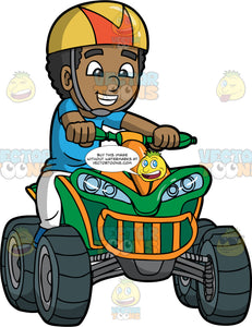 A Cute Black Boy Sitting On His Green and Orange Quad Bike. A black boy wearing white pants, a blue t-shirt, and gold and orange helmet, holds onto the handlebars of his green and orange all terrain vehicle as he happily rides around on it