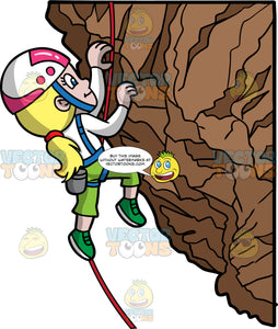A Girl Carefully Climbing A Rock Formation. A girl with blonde hair tied in a low ponytail, wearing green pants, green rock climbing shoes, a white shoes, a blue harness, and a white and pink helmet, using her hands and rope to climb up a rock mountain