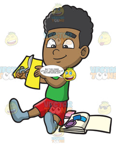 A Black Boy Cutting Paper For Scrapbooking