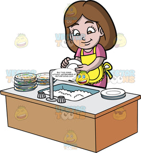 A Girl Washing A Stack Of Dirty Dishes. A girl with brown hair and eyes, wearing a pink dress and yellow apron, standing behind a sink filled with soapy water and washing a stack of dirty dishes that are piled up next to the sink