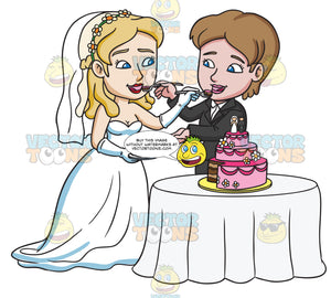 A Lesbian Couple Feeding Each Other A Slice Of Wedding Cake