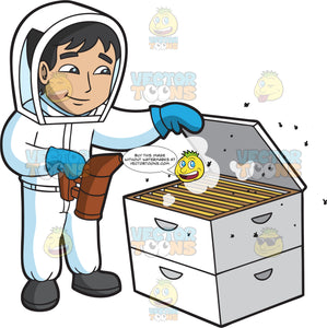 A Young Male Beekeeper Smoking The Hive