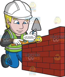 A Male Bricklayer Doing Some Leveling