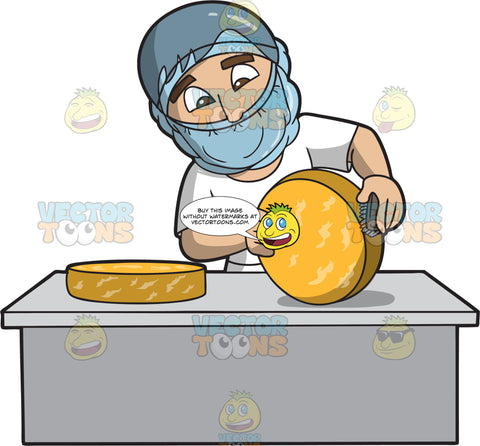 A Male Cheese Maker Scrubbing The Cheese Truckle Rind
