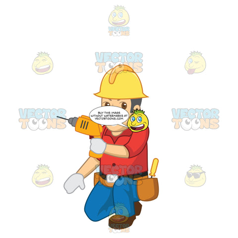 Male Construction Worker Kneeling Down Using A Drill