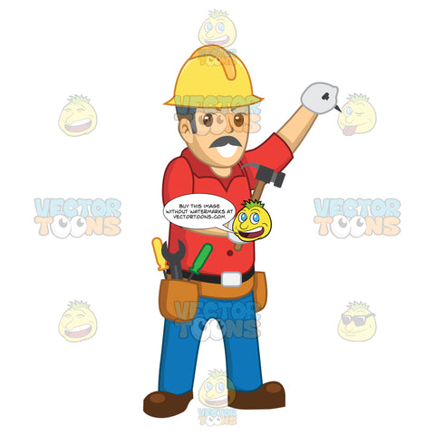Male Construction Worker Holding A Nail To The Wall While Holding A Hammer
