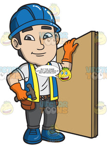 A Male Construction Worker Holding Plywood