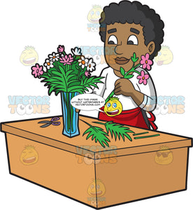 A Male Florist Arranging A Vase Of Flowers