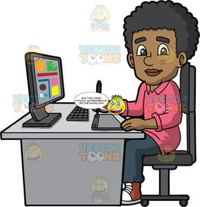 A Black Male Graphic Designer Using A Drawing Pad. A black man with curly hair, wearing a pink sweatshirt, dark grayish teal pants, brown with white sneakers, smiles while sitting on a dark gray chair behind a light gray desk with a desktop monitor, a keyboard, notebook, and drawing pad with pen, as he designs some graphics