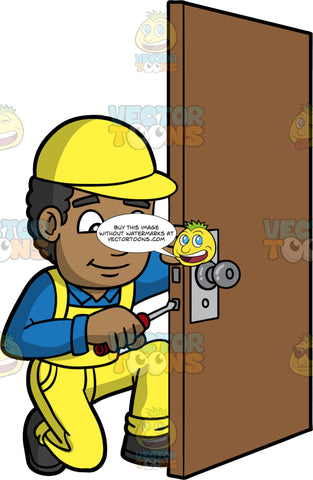 A Black Male Locksmith Fixing The Lock On A Door. A black man wearing yellow overalls over a blue shirt, a yellow hat, and black work boots, kneeling down and placing a screwdriver in the side of a door in order to fix the locking mechanism
