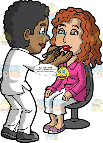 A Black Male Makeup Artist Lining The Lips Of A Woman. A black male makeup artist with curly hair, wearing a white polo shirt, pants, dark gray sneakers, smiles while lining the lips of a female client with curly brown hair, wearing a pink blouse, white pants, purple with white shoes, sitting on a black chair, using a lip pencil in his left hand