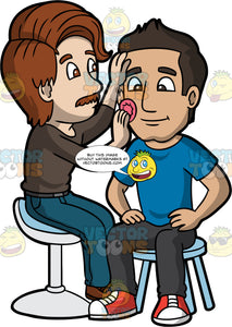 A Male Makeup Artist Applying Foundation On A Man's Face. A male makeup artist with brown hair, mustache, wearing a dark brown sweatshirt, blue jeans, black belt, brown shoes, sitting on a white chair, applies foundation on a male client with black hair, wearing a blue shirt, black pants, red and white sneakers, who is sitting patiently on a light blue stool chair, using a pink sponge