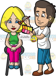 A Male Makeup Artist Applying Blush On A Female Client. A male makeup artist with dark brown hair, wearing a white shirt, teal cropped jeans, brown shoes, smiles while applying blush on the face of a woman with blonde hair, wearing a green sleeveless shirt, white belt, hot pink pants, teal shoes, sitting on a dark gray stool, using a brush and a palette of blush
