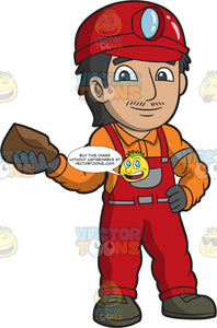A Male Miner Holding A Brown Rock