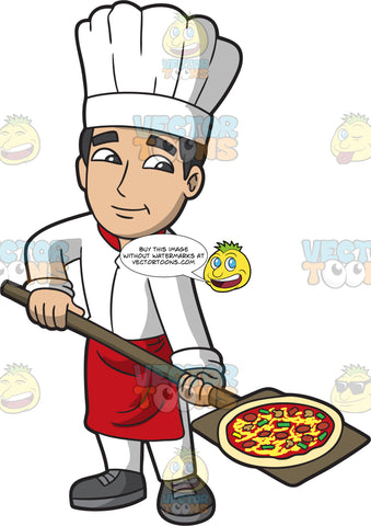 A Nice Male Pizza Maker Baking A Pizza