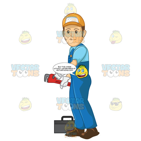 Male Plumber Using A Wrench While Standing