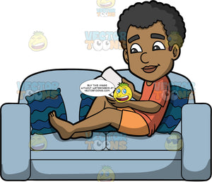 Jimmy Reading A Good Book. A black man wearing orange shorts and a dark orange t-shirt, relaxing on a light blue sofa while he reads a book