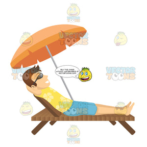Male Tourist Laying On A Beach Chair Under An Umbrella