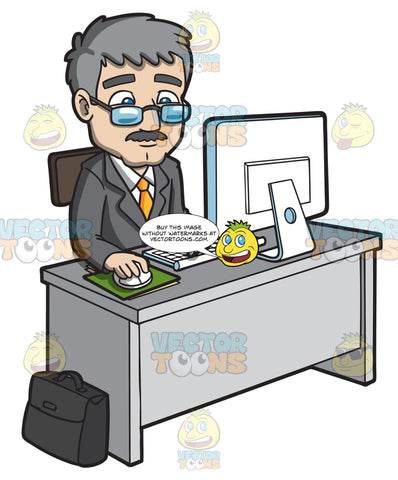 A Mature Businessman Using The Computer