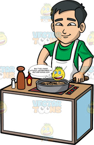Kevin Adding Salt To The Food He Is Cooking. An Asian man wearing a green t-shirt, and white apron, standing behind a stove, cooking something in a large frying pan, and adding some salt with his fingers