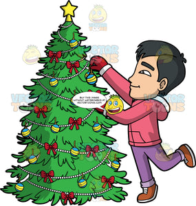 Kevin Putting An Ornament On A Christmas Tree. An Asian man wearing lavender pants, a pink hoodie, red mittens, and brown shoes, standing on one foot and reaching up to put a round ornament on a Christmas tree