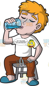 A Guy Drinking A Glass Of Water