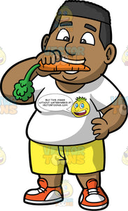 James Taking A Bite Out Of A Carrot. A black man wearing yellow shorts, a white t-shirt, and orange and white running shoes, standing with one hand on his hip, while holding a carrot in the other hands and taking a bite out of it