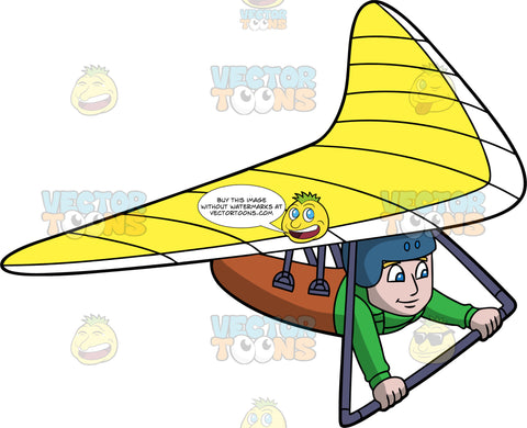 A Man Gliding Through The Air In A Yellow Hang Glider. A man wearing a green shirt and blue helmet, hangs onto the bar of the yellow hang glider he is strapped into
