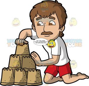 A Man Sculpting The Sandcastle He Built. A man with brown hair and eyes, wearing red shorts and a white t-shirt, kneeling in the sand and sculpting the three tiered sandcastle he has built