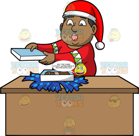 James Opening A Christmas Present. A black man wearing a red sweater and a Santa hat, standing behind a table and taking the lid off a gift box