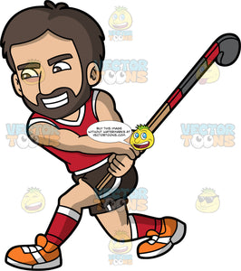 A bearded man getting ready to hit a ball with his field hockey stick. A man with dark brown hair and beard, wearing black shorts and a red tank top, red socks and orange shoes, grins as he lifts up his field hockey stick and prepares to swing at a ball