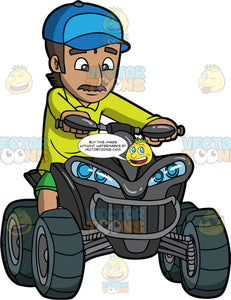 An Indian Man Driving A Black Quad Bike. An Indian man wearing green shorts, lime green tunic shirt, and blue baseball cap, sits on a black all terrain vehicle and drives it around for the first time